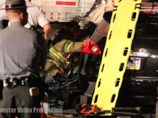 Rescue technicians working to extricate trapped driver.