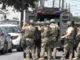 SWAT members moving in
