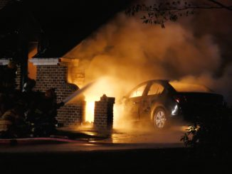Car burning in house